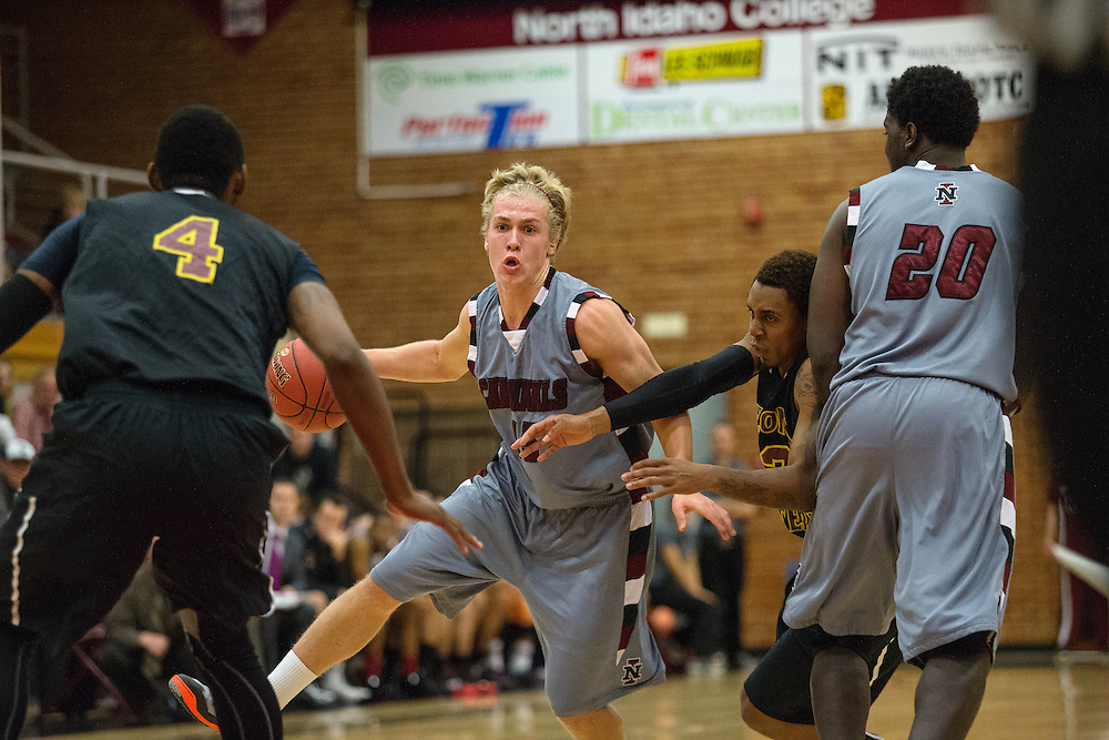 GABE GREEN/Press<br /> <br /> NIC Freshman Cole Kesler bounds through Arizona Western players on his way to the hoop Saturday.