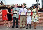 Jennifer Judkins, left, and Zaneta Sampson, right, of Longines, present owner Stuart Janney, assistant trainer Robert Medina and jockey Javier Castellano, left to right, with Longines Conquest Classic timepieces after their horse Ironicus won the Longines Dixie Stakes, Saturday, May 16, 2015, at Pimlico Race Course in Baltimore, Md.  Longines, the Swiss watch manufacturer known for its elegant timepieces, is the Official Watch and Timekeeper of the 140th annual Preakness Stakes and the Triple Crown. (Photo by Diane Bondareff/Invision for Longines/AP Images)