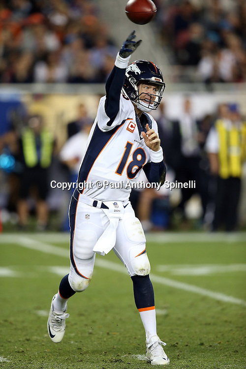 Denver Broncos quarterback Peyton Manning (18) throws a fourth quarter pass for a completion and a short gain during the NFL Super Bowl 50 football game against the Carolina Panthers on Sunday, Feb. 7, 2016 in Santa Clara, Calif. The Broncos won the game 24-10. (©Paul Anthony Spinelli)