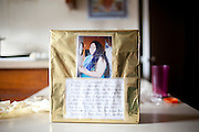 A donation box showing Monica Barajas and a plea for help seen in her family's home in East Point, Georgia December 30, 2009. Monica had to move to Mexico to continue dialysis treatment after Grady Hospital stopped her treatment and has been separated from her son and husband.