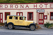 Cadrona Hotel with a classic antique car on the way between Queenstown and Wanaka on the high road that also accesses the ski field of Cadrona.
