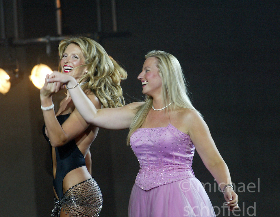 Michelle Mone, owner of the Ultimo range, with Penny Lancaster, girlfriend of singer Rod Stewart, models items from the new Ultimo Lingerie Show at the Clyde Auditorium, Glasgow. August 30th, 2003.