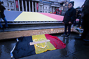 UNITED KINGDOM, London: 24 March 2016. People pay there respects during a vigil heard in Trafalgar Square after the terrorist attacks in Belgium on the 22nd in London.  Pic by Andrew Cowie / Story Picture Agency