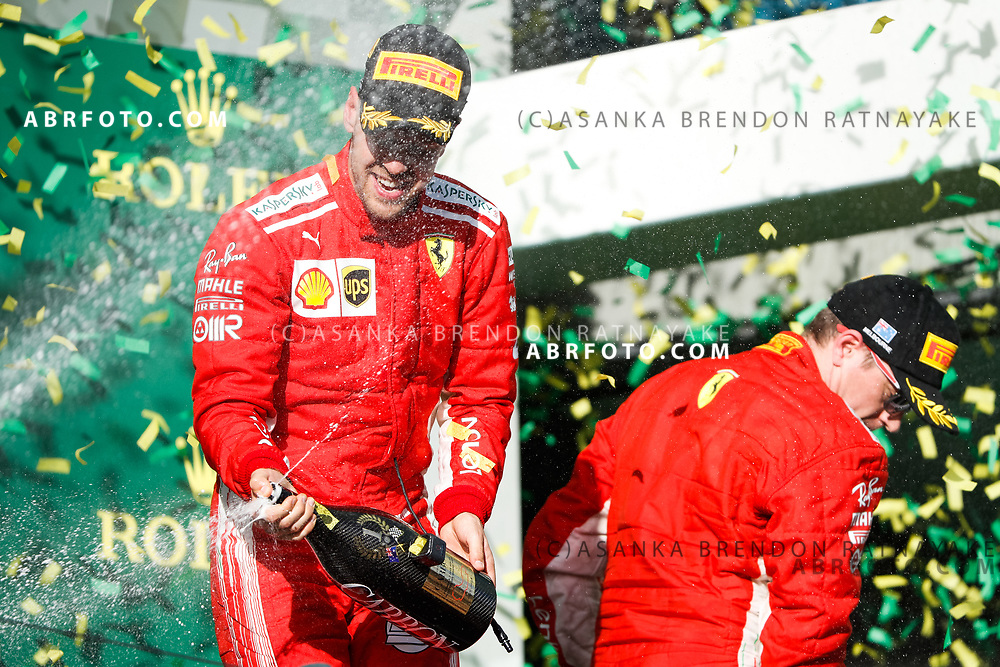 Victorious Ferrari driver Sebastian Vettel of Germany celebrates spraying champagne on the podium during the trophy presentation at the end of the 2018 Rolex Formula 1 Australian Grand Prix at Albert Park, Melbourne, Australia, March 24, 2018.  Asanka Brendon Ratnayake
