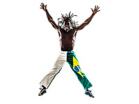one Brazilian black man jumping arms outstretched on white background