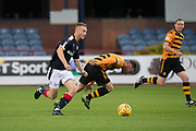 Dundee&rsquo;s Matty Hanvey goes past  Alloa Athletic's former Dee Daryll Meggatt - Dundee under 20s v Alloa Athletic in the Irn Bru Cup Round 1 at Dens Park, Dundee - photograph by David Young<br /> <br />  - &copy; David Young - www.davidyoungphoto.co.uk - email: davidyoungphoto@gmail.com