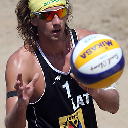 DURBAN, SOUTH AFRICA - DECEMBER 14: Aleksandrs Samoilovs of Latvia during the Men's second semi-final between Bruno Oscar Schmidt and Pedro Solberg Salgado of Brazil and Aleksandrs Samoilovs and Janis Smedins of Latvia at the FIVB Durban Open at New Beach on December 14, 2013 in Durban, South Africa.  (Photo by Steve Haag/Getty Images for FIVB)