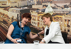 Pictured: Nicola Sturgeon chats with senior lecturer Maria Economou from Greece.<br /> <br /> SNP leader Nicola Sturgeon met workers at Glasgow University from the EU ahead of next week's European elections.<br /> <br /> © Dave Johnston / EEm