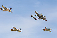 Warbirds perform during Los Angeles County Air Show in Lancaster, California on March 21, 2015. (Photo by Ringo Chiu/PHOTOFORMULA.com)