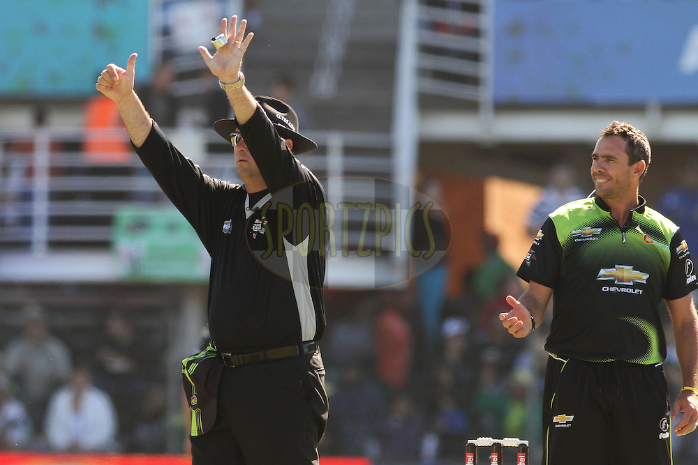 Umpire Johanes Cloete signals a six as Nicky Boje of the Warriors looks on during match 2 of the Airtel CLT20 between The Warriors and The Wayamba Elevens held at St Georges Park in Port Elizabeth on the 11 September 2010..Photo by: Shaun Roy/SPORTZPICS/CLT20