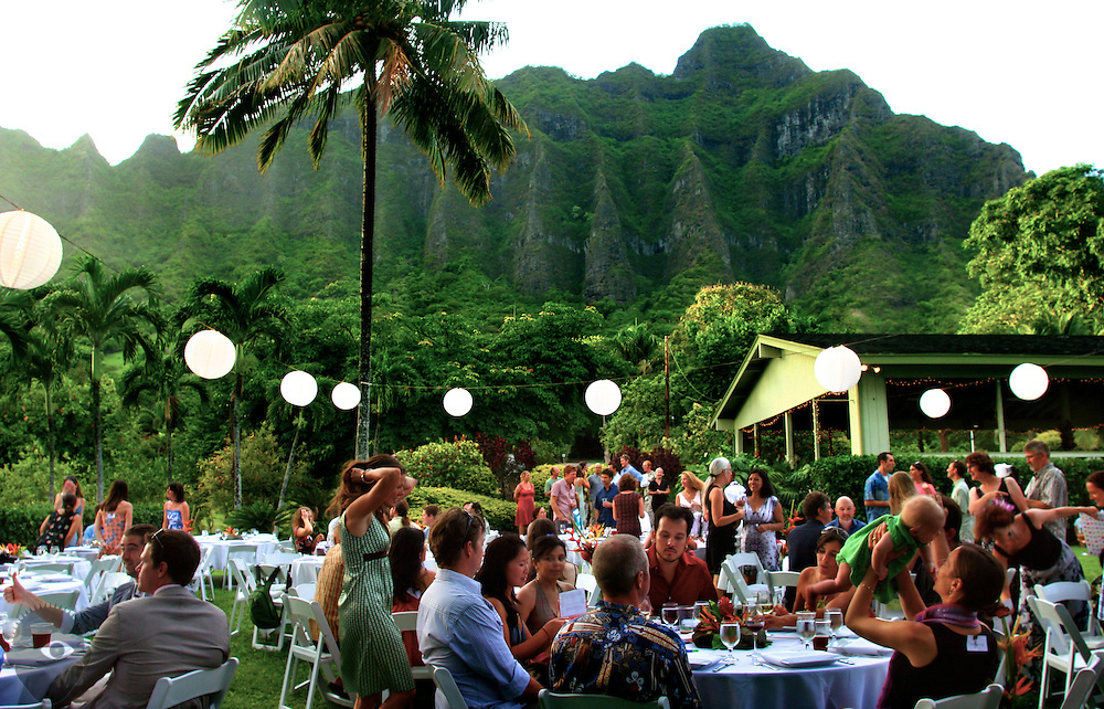 Family and friends await newly wed Kim and Joalyn as their wedding reception is due to begin at Moli'i Pond about Kualoa Regional Park on the east end of Oahu.