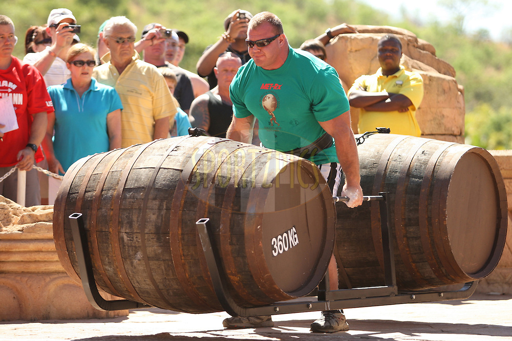 Derek Poundstone (USA) sets off in the whiskey-barrel walk during the final rounds of the World's Strongest Man competition held in Sun City, South Africa.