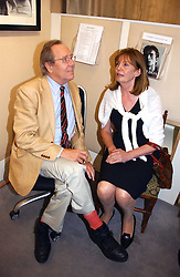 The EARL OF SNOWDON and his former wife LUCY, COUNTESS OF SNOWDON at an exhibition of photographs by Lord Snowdon held at the Chris Beetles Gallery, Ryder Street, London on 18th September 2006.<br />