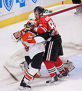 Dan Carcillo and Blackhawks Toamas Kopecky trade blows late in the first period, Carchillo recieved an unsportsmanlike conduct penalty, Kopecky was called for roughing.(Ed Hille / Staff Photographer) flyr01 May 31, 2010 116909 EDITORS NOTE:  STANLEY CUP FINALS Game 2 at the United Center in Chicago. FIRST PERIOD YEAREND-eh01