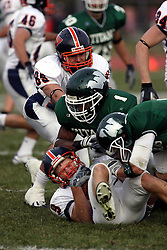 10 November 2007: Alex Pokorny gets tackled by Brandon Patrick.  This game between the Wheaton College Thunder and the Illinois Wesleyan University Titans was for a share of the CCIW Championship and was played at Wilder Field on the campus of Illinois Wesleyan University in Bloomington Illinois.