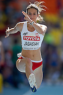Anna Jagaciak from Poland competes in women's triple jump qualification during the 14th IAAF World Athletics Championships at the Luzhniki stadium in Moscow on August 13, 2013.<br /> <br /> Russian Federation, Moscow, August 13, 2013<br /> <br /> Picture also available in RAW (NEF) or TIFF format on special request.<br /> <br /> For editorial use only. Any commercial or promotional use requires permission.<br /> <br /> Mandatory credit:<br /> Photo by © Adam Nurkiewicz / Mediasport