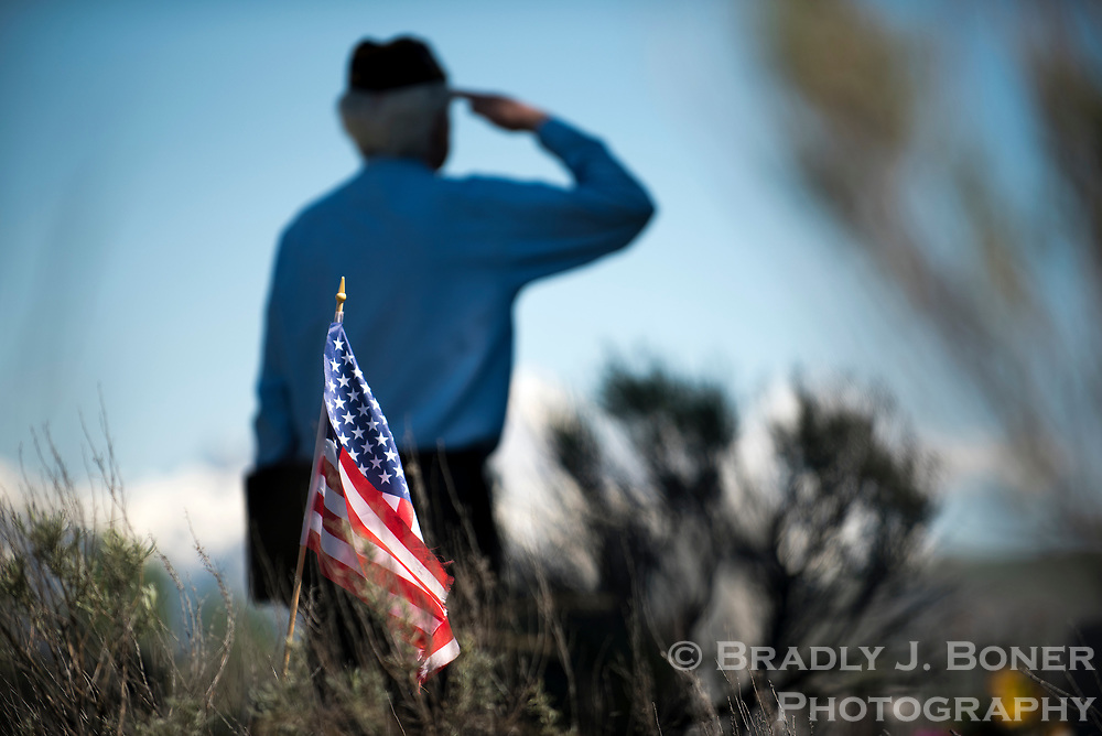American Legion Post 43 chaplain Paul Barbour salutes as Taps is played Monday during a Memorial Day ceremony at South Park Cemetery. Legion members conduct the ceremonies at cemeteries throughout the valley on Memorial Day to honor fallen service members.
