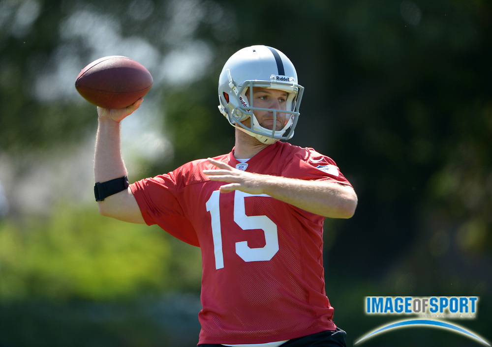 Jun 3, 2013; Alameda, CA, USA; Oakland Raiders quarterback Matt Flynn (15) throws a pass at organized team activities at the Raiders practice facility.