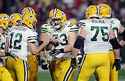 Green Bay Packers quarterback Aaron Rodgers (12) talks to Green Bay Packers center Corey Linsley (63) as the Green Bay Packers offense huddles and calls a play during the NFL NFC Divisional round playoff football game against the Arizona Cardinals on Saturday, Jan. 16, 2016 in Glendale, Ariz. The Cardinals won the game in overtime 26-20. (©Paul Anthony Spinelli)