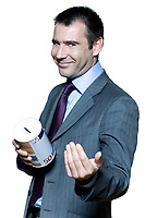 portrait on isolated white background of a smiling  businessman holding a moneybox begging for money