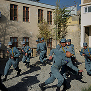 Afghan National Police (ANP) cadets react to a simulated attack by Taliban during combat exercises at the Afghan Nacional Police Academy.<br />