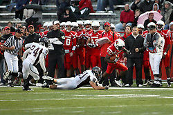 25 September 2010:  Marvon Sanders escapes the grasp of Skylar Smith and continues his romp up the sidelines.  The Missouri State Bears lost to the Illinois State Redbirds 44-41 in double overtime, meeting at Hancock Stadium on the campus of Illinois State University in Normal Illinois.