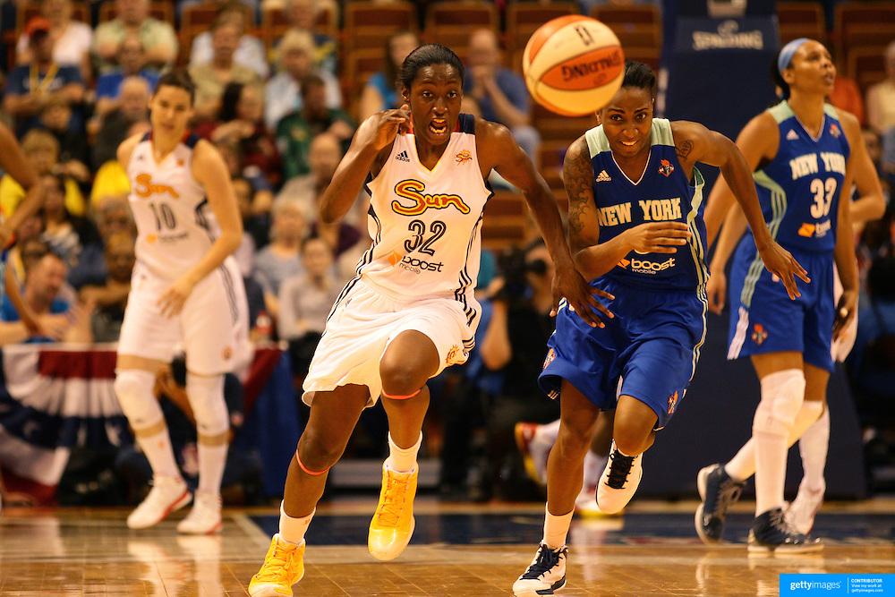 Kalana Greene, (left), Connecticut Sun and Shenneika Smith, New York Liberty, challenge for a loose ball during the Connecticut Sun V New York Liberty WNBA pre season game at Mohegan Sun Arena, Uncasville, Connecticut, USA. 11th May 2013. Photo Tim Clayton