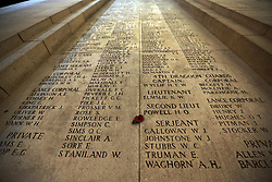 A lone poppy placed amongst the names inscribed at the Menin Gate in Ypres, Belgium, Sunday, 10th November 2013 , where the Duke of Edinburgh will attend a Last Post ceremony  to mark the gathering of soil from Flanders Fields for a memorial garden at the Guards Museum in London, on Armistice Day tomorrow (Monday 11th November)  Picture by Stephen Lock / i-Images