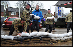 Prince William and Prince Harry put sandbags out in the village of Datchet as they help the communities affected by the floods in the UK. Friday, 14th February 2014. Picture by Andrew Parsons / i-Images