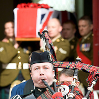 The Military funeral of Corporal Johnathan Moore, The Royal Scots Borderers, 1st Battalion, The Royal regiment of Scotland held at Cadzow Parish Church, Woodside Walk, Hamilton.  Pictured is the Piper leading the coffin out of the church.  Picture Christian Cooksey.