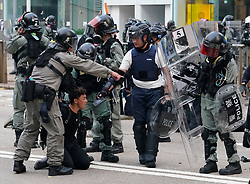 Hong Kong. 29 September, 2019. Illegal march by thousands of pro-democracy supporters from Causeway Bay to Government offices at Admiralty. Police unsuccessfully tried to stop march at start with teargas fired and scuffles. March marked the 5th anniversary of the start of the Umbrella Movement. Arrest of protestor at Admiralty district.