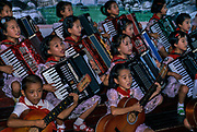 NORTH KOREA: Pyongyang<br /> Young children perform synchronised singing and music at the Academy for Children