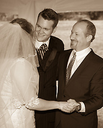 bride with her brother and father after the ceremony