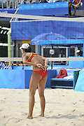 Beijing, CHINA.   Beach Volleyball - Beijing Olympic Basketball Venue,  Black Kit - China 1 Player No. 1 Jie WANG and No. 2 Jia TAIN, and CHN 4 Player No. 1 Chen XUE and No.2 Xi ZHANG.  Tuesday - 19/08/2008  [Mandatory Credit: Peter SPURRIER, Intersport Images