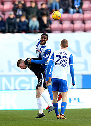 Cheyenne Dunkley of Wigan Athletic beats Andy Cannon of Rochdale to a header - Mandatory by-line: Robbie Stephenson/JMP - 24/02/2018 - FOOTBALL - DW Stadium - Wigan, England - Wigan Athletic v Rochdale - Sky Bet League One