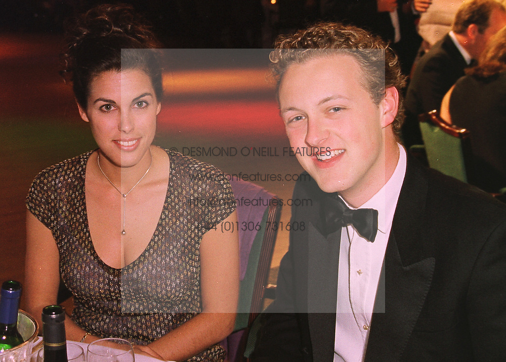 MISS JESSICA DE ROTHSCHILD daughter of Sir Evelyn de Rothschild and LORD EDWARD SPENCER-CHURCHILL son of the Duke of Marlborough, at a ball in London on 21st May 1998.MHW 53