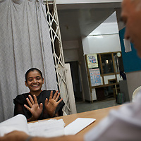 Vasanti Shinde, age 26, with doctors at the Save Foundation's homeopathic surgery in Sangli. Vasanti is HIV positive. Her CD4 count has increased with homeopathic medicine.  <br />