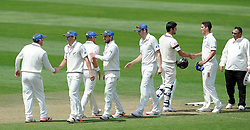 The New Zealand players shake hands after victory over Somerset. Photo mandatory by-line: Harry Trump/JMP - Mobile: 07966 386802 - 11/05/15 - SPORT - CRICKET - Somerset v New Zealand - Day 4 - The County Ground, Taunton, England.