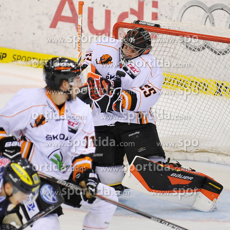03.10.2014, Saturn Arena, Ingolstadt, GER, DEL, ERC Ingolstadt vs Grizzly Adams Wolfsburg, 7. Runde, im Bild Torwart Sebastian Vogl (Grizzly Adams Wolfsburg) 25 klaert mit der Brust // during germans DEL Icehockey League 7th round match between ERC Ingolstadt and Grizzly Adams Wolfsburg at the Saturn Arena in Ingolstadt, Germany on 2014/10/03. EXPA Pictures &copy; 2014, PhotoCredit: EXPA/ Eibner-Pressefoto/ Schreyer<br /> <br /> *****ATTENTION - OUT of GER*****