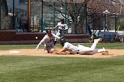 14 April 2013:  Anthony Lopez dives for the third base bag as Chris Fisher fields the pick off throw during an NCAA division 3 College Conference of Illinois and Wisconsin (CCIW) Baseball game between the Elmhurst Bluejays and the Illinois Wesleyan Titans in Jack Horenberger Stadium, Bloomington IL