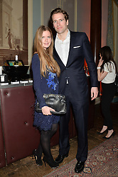 KATIE READMAN and WILF FROST at a party to celebrate 25 years of the Magnum ice ream held at home House, 20 Portman Square, London on 26th March 2014.