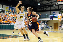 19 March 2010: Meredith Kussmaul turns towards the hoop blocked by Amy Woods. The Flying Dutch of Hope College defeat the Yellowjackets of the University of Rochester in the semi-final round of the Division 3 Women's Basketball Championship by a score of 86-75 at the Shirk Center at Illinois Wesleyan in Bloomington Illinois.