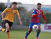 Newport County player Aaron Collins and Dagenham defender Josh Passley race each other for the loose ball during the Sky Bet League 2 match between Dagenham and Redbridge and Newport County at the London Borough of Barking and Dagenham Stadium, London, England on 19 September 2015. Photo by Bennett Dean.