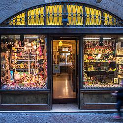 Bergamo, Italy - A child runs towards a toy store in Via Gombino, the main street of the historical centre of Città Alta, Upper Bergamo