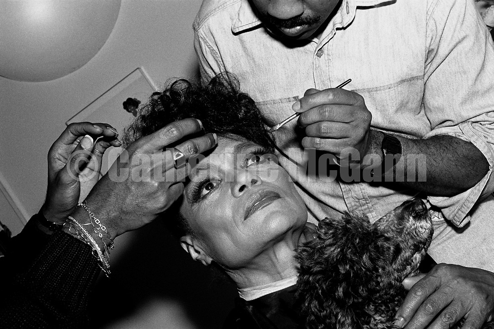 NEW YORK - MAY 19:  American actress and singer Eartha Kitt, holds her dog while having her makeup applied backstage before a show at the Ballroom  on May 19, 1987 in New York City, New York.  (Photo by Catherine McGann)Copyright 2010 Catherine McGann