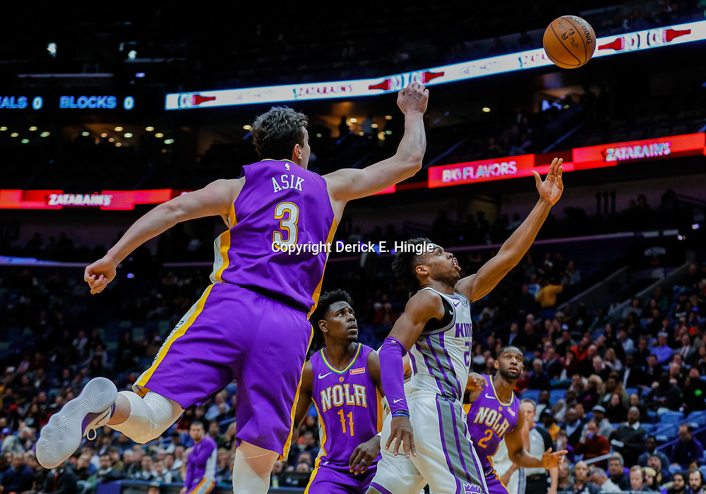 Jan 30, 2018; New Orleans, LA, USA; Sacramento Kings guard Buddy Hield (24) shoots over New Orleans Pelicans center Omer Asik (3) during the first quarter at the Smoothie King Center. Mandatory Credit: Derick E. Hingle-USA TODAY Sports