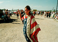 Photo by Jeremy Hogan.Woman trying to get mircale ticket for Further Festival Concert in Bonner Springs, Kansas 1996. deadhead, hippy, counterculture, American flag, people, cars, trucks, concert, 90s, gen x, generation X, concepts, asking, wanting, needing, entrance,
