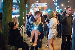 """© Licensed to London News Pictures . 16/12/2017. Manchester, UK. A man lifts and carries a woman on Deansgate Locks . Revellers out in Manchester City Centre overnight during """" Mad Friday """" , named for historically being one of the busiest nights of the year for the emergency services in the UK . Photo credit: Joel Goodman/LNP"""