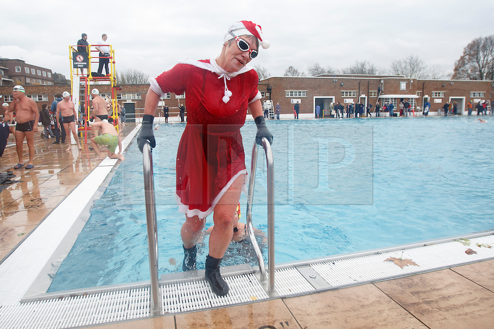 © licensed to London News Pictures. London, UK 07/12/2013. About 400 people swimming in 7C degrees cold Parliament Hill, Lido swimming poll in north London during the December Dip event by Outdoor Swimming Society on Saturday, 7 December 2013. The poll temperature is 7C degrees. Photo credit: Tolga Akmen/LNP