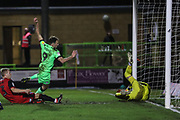 Forest Green Rovers Christian Doidge(9) shoots at goal scores a goal 2-0 during the EFL Sky Bet League 2 match between Forest Green Rovers and Grimsby Town FC at the New Lawn, Forest Green, United Kingdom on 22 January 2019.